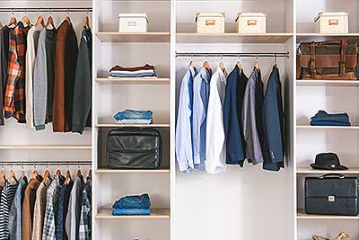 clothes neatly organized in a closet